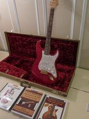 Wayne's Fender guitar, and his 4 books.