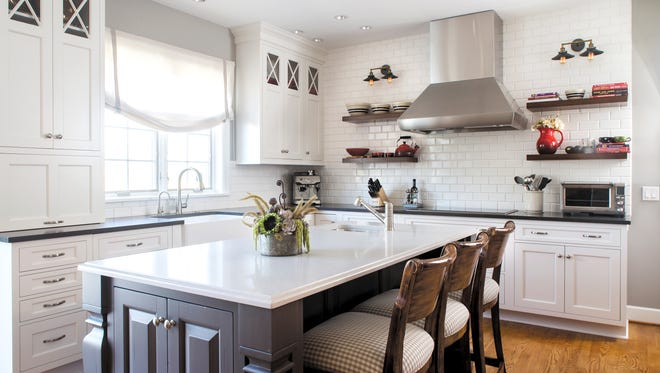 "This project, done by Concept II, is all about grays and whites, the two ""it"" colors in local kitchens."