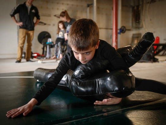 Sebastiano Fidone, 6, practices his moves on a wrestling