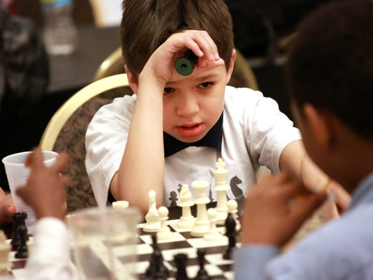 Alberto Jimenez, 9, of Detroit looks up at his opponent