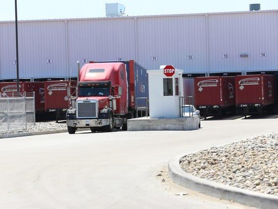 A truck leaves a Crown Enterprises, a Manuel Moroun,