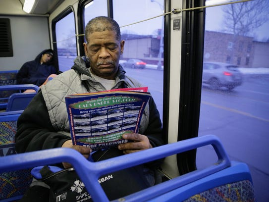James Robertson of Detroit looks over ads for used