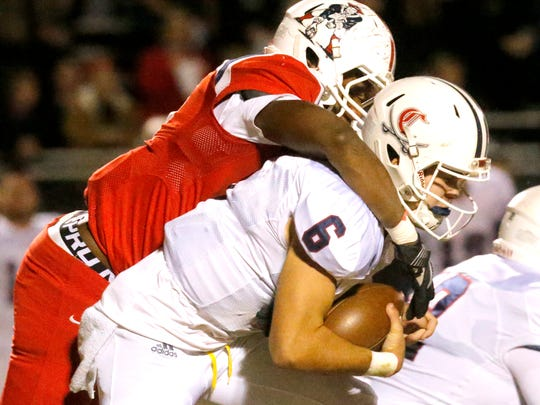 Cookeville's quarterback Cade Smith (6) is sacked by Oakland's Aaron Moore (36) during the  third round of play-off games against Oakland, on Friday, Nov. 17, 2017, at Oakland.