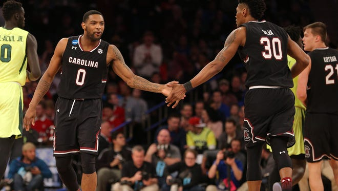 South Carolina Gamecocks guard Sindarius Thornwell (0) celebrates with forward Chris Silva (30) during the second half against the Baylor Bears in the semifinals of the East Regional of the 2017 NCAA Tournament at Madison Square Garden.