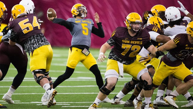 Arizona State's Manny Wilkins throws a pass during practice at ASU, Friday, April 8, 2016.