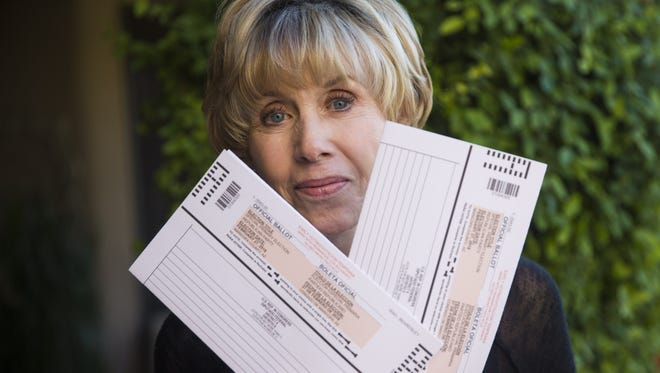 Evie Hendrick holds two election ballots she received in the mail at her home in Glendale on Feb. 6, 2018. She accidentally received two ballots for the special election to fill the vacant Congressional District 8 seat.