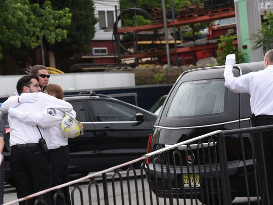 The funeral for 27-year veteran of Nutley Volunteer Emergency and Rescue Squad, Michael J. Rossi Jr., 51, of Union, at Holy Family Church in Nutley on Tuesday May 23, 2017.