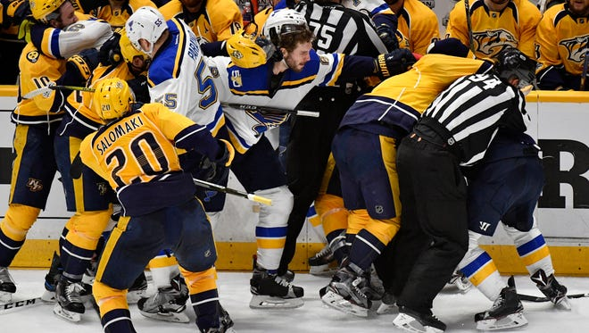 The Predators and Blues fight during the third period of Game 4 on Tuesday, May 2, 2017.