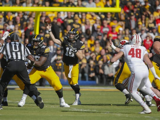 Iowa quarterback C.J. Beathard wound up completing 17 of 33 passes for 153 yards against Wisconsin, with a long of 21 yards on a catch-and-run from Akrum Wadley.