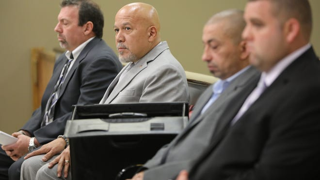 "Paterson Mayor Joey Torres, second from left, sits among his three co-defendants in state Superior Court in Hudson County in June. From left are Joseph Mania, Imad ""Eddie"" Mowaswes and Timothy Hanlon."