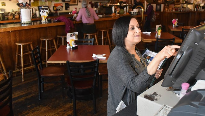 Tonya DeYapp works at Three Rivers Restaurant on Friday. On Saturday, the restaurant will offer a special dinner, and proceeds will go to help defray the costs associated with DeYapp's kidney transplant.