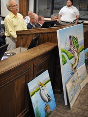 Wichita Falls mural artist Ralph Stearns make a presentation to the Wichita Falls City Council in the fall 2017, displaying mock-ups of the large mural he plans to paint on the east wall of the spillway at Lake Wichita. The council approved the project, but funding must still be acquired from private donations.