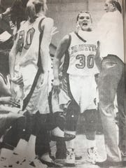 Union County coach Gerald Tabor attempted to calm down Nikki Thompson during the final seconds of a Bravettes game against Madisonville in January 1996.