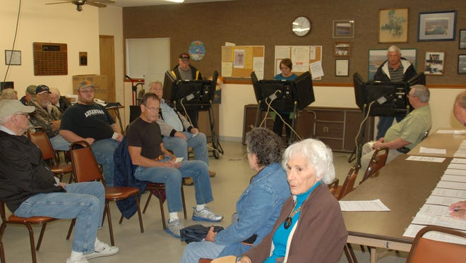 Voters wait to cast their votes in Bull Shoals about 12:45 p.m. The wait to vote is about 30 minutes.