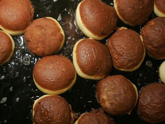 Paczki (or doughnuts) in vegetable oil at Garfield