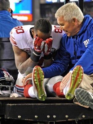 Victor Cruz is overcome as he is carted off the field.