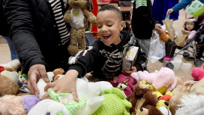 """I like this bunny! It's so cute,"" said Orlando Cruz, after grabbing the stuffed rabbit off the table during the Three Kings Day Community Fair and Toy Distribution at William Penn High School on Saturday. The family of the 6-year-old from York was one of 86 that were provided with information about York services and given toys for the kids during the third annual event."