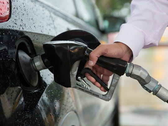A man fills his gas tank on Wednesday, June 7, 2017
