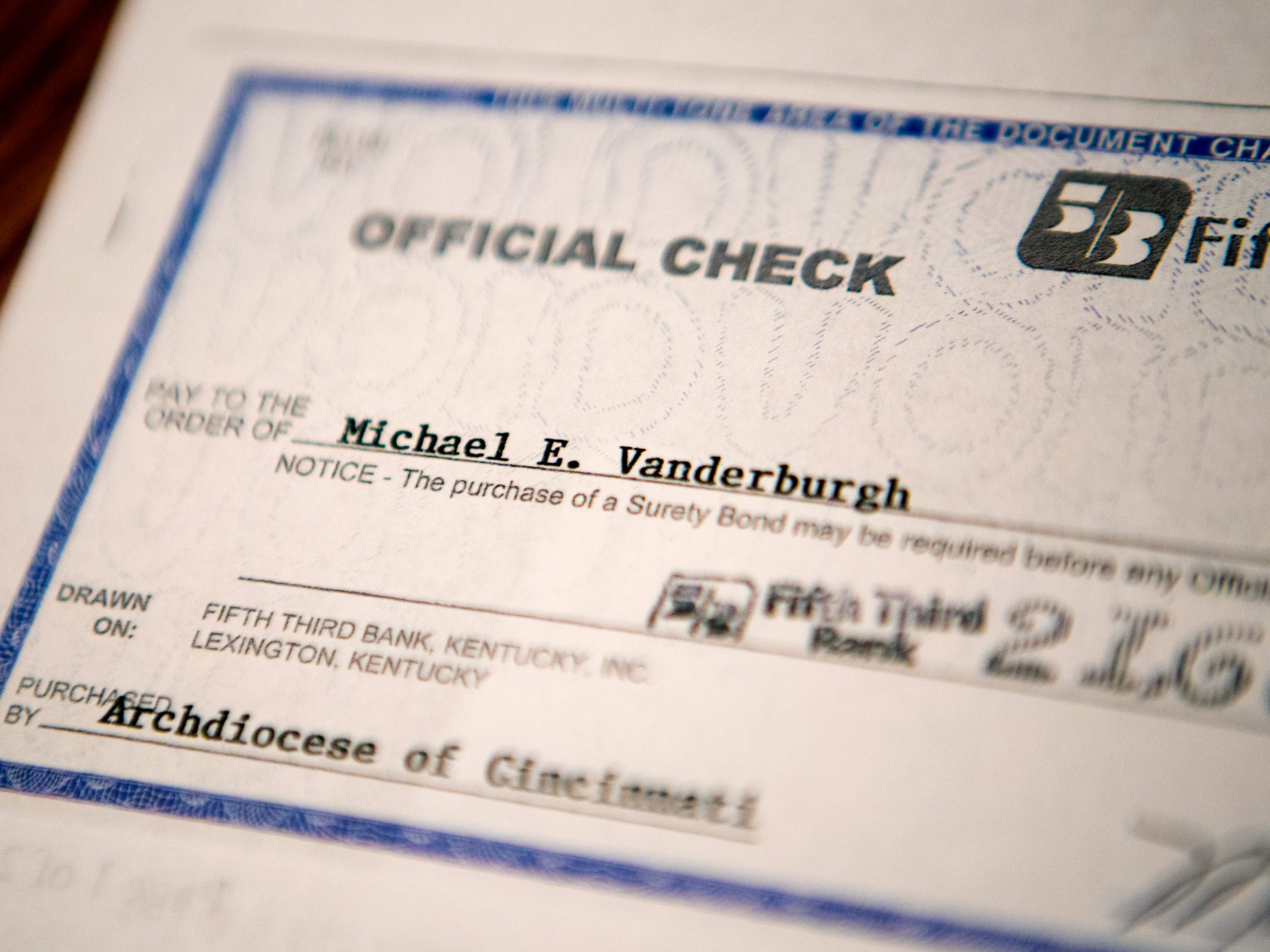 Michael keeps a copy of the check he received from