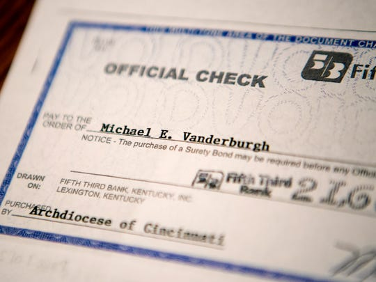 Michael keeps a copy of the check he received from the Archdiocese of Cincinnati in a file in his basement. A tribunal set up to compensate victims of clergy abuse approved the payment.
