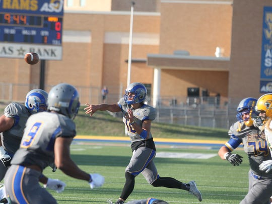 Angelo State quarterback Jake Faber throws a pass during