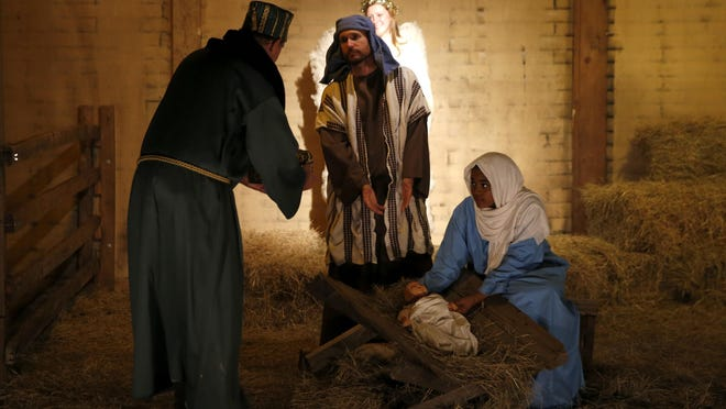 Church members portray Mary and Joseph in the manger scene with baby Jesus and the three wise men for living Christmas story at Killearn United Methodist Church, which has put on the display for 33 years.