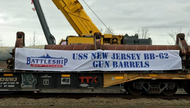 W. O Grubb Crane company lifts and sets a historic 16 inch/50 caliber naval gun barrel onto a Norfolk Southern Corp. rail car from a Navy storage site in Virginia. It is headed back to the battleship New Jersey, now a museum in Camden. That weapon and two other identical barrels headed to other display destinations were all fired in the ship's main gun turrets during World War II and the Korean War but were later replaced and stored by the Navy.