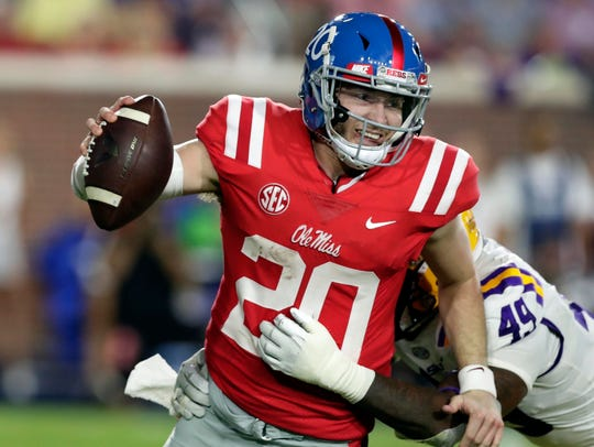 Mississippi quarterback Shea Patterson is sacked by