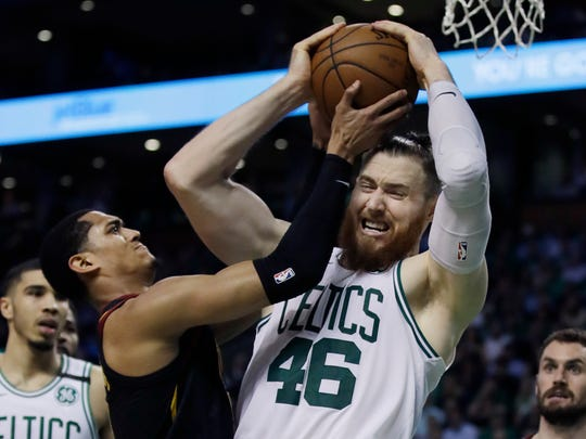 Boston Celtics center Aron Baynes (46) competes for a rebound against Cleveland Cavaliers guard Jordan Clarkson during the second quarter of Game 5 of the NBA basketball Eastern Conference finals Wednesday, May 23, 2018, in Boston. (AP Photo/Charles Krupa)