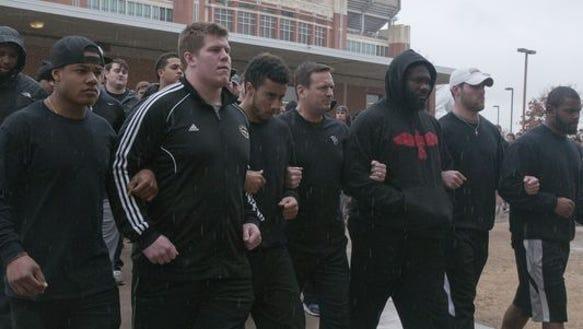 The University of Oklahoma football team (with head