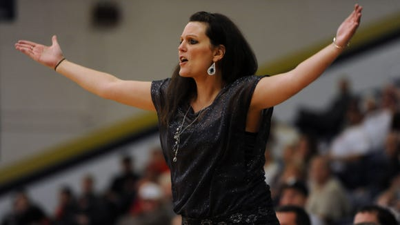 McDowell girls basketball coach Jennifer Brooks and the Titans were among the many Western North Carolina teams who had games postponed Thursday.