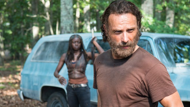 "Andrew Lincoln, at right,  as Rick Grimes and Danai Gurira as Michonne in the AMC television series ""The Walking Dead"""