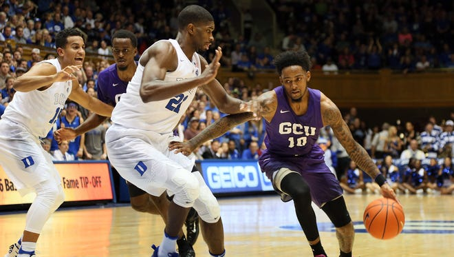 Nov 12, 2016; Durham, NC, USA; Lopes guard Shaq Carr (10) drives against Blue Devils Jefferson (21) in the first half of their game at Cameron Indoor Stadium.