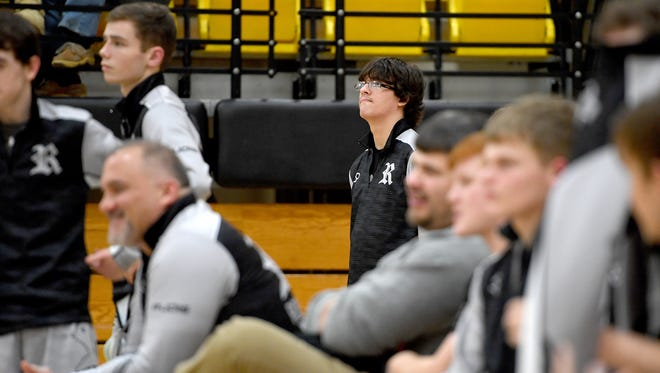 Robbinsville High School junior wrestler Jamie Kirl watches his teammates on the mat during a match at Hayesville High School on Wednesday, Jan. 10, 2018. Kirl runs The Kirl Report, a Facebook page where he gives video commentary after Black Knights' matches as well as interviews with wrestlers.