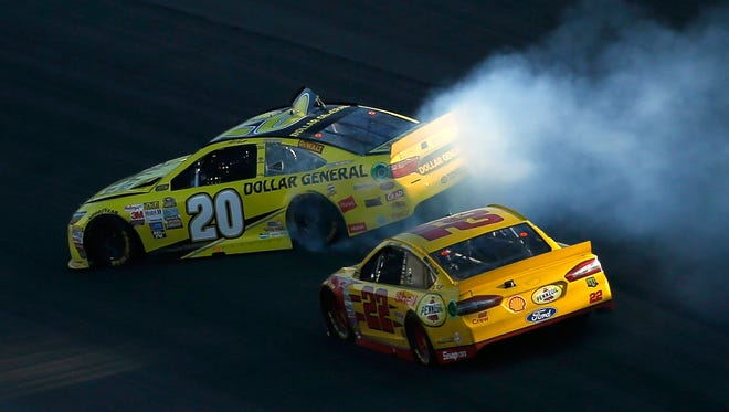 Matt Kenseth spins as Joey Logano races by en route to a victory Sunday at Kansas Speedway. Kenseth was upset by Logano's actions.