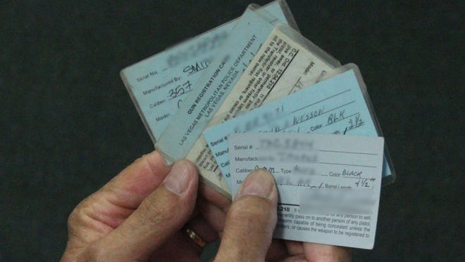 A man holds his blue cards Thursday morning.