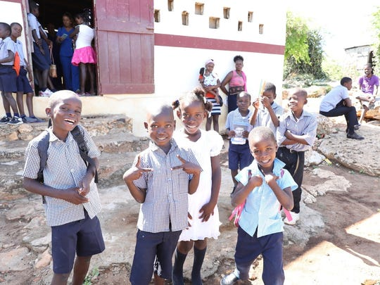 School-age children wait for their evaluation by the