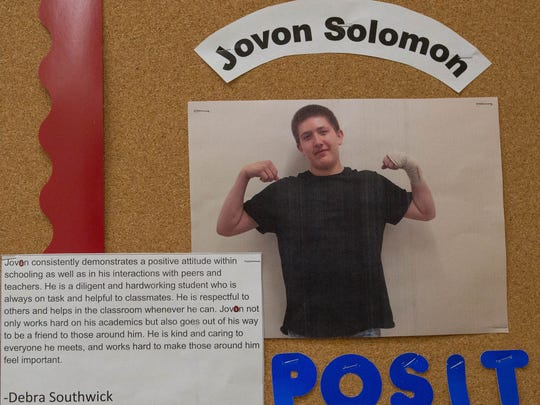 A photo of Jovon Solomon pinned to a bulletin board