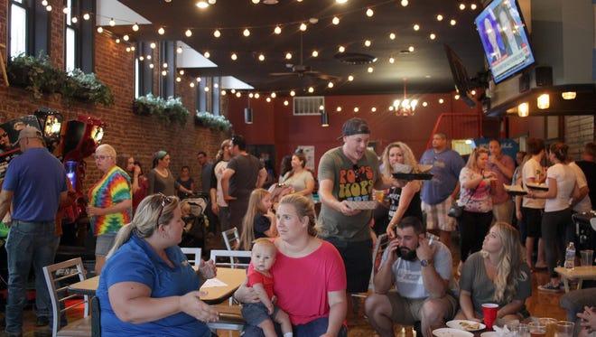 Folks enjoy the giant game room in Filly's restaurant in Gallatin, TN on Thursday, June 21, 2018.