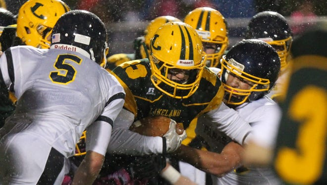 Lakeland's Keir Maley fights through the Panas line during their game at Lakeland Oct. 2, 2015.