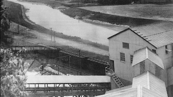 """An Army Corps of Engineers photo, dated September 4, 1942, was annotated by the Corps as taken from the """"top of building of Neuman Sand and Supply Company, looking upstream,"""" i.e. looking southward along the Codorus Creek."""