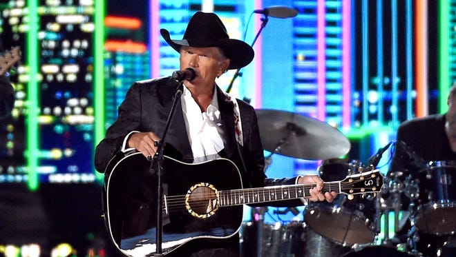 Honoree George Strait performs onstage during the 50th Academy Of Country Music Awards at AT&T Stadium on April 19, 2015 in Arlington, Texas.