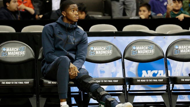Injured Xavier Musketeers guard Edmond Sumner (4) watches from the sideline during a practice session ahead of the NCAA Tournament Sweet 16 matchup between the Xavier Musketeers and the Arizona Wildcats at the SAP Center in San Jose, Calif., on Wednesday, March 22, 2017.