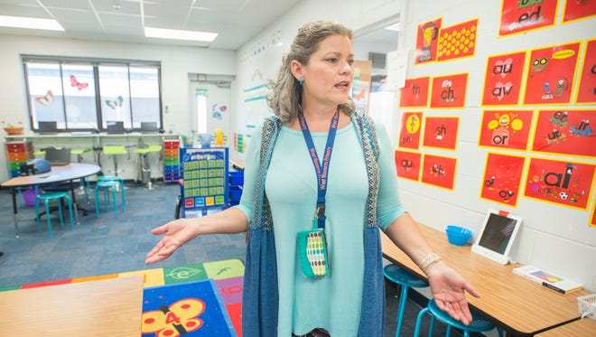 First grade teacher Jami Moore gives a tour of her tiny classroom (room 412) at West Navarre Primary School in Navarre on Thursday, March 15, 2018.  Ever increasing population growth has lead to overcrowding in schools.  The Santa Rosa County School District plans on building additional schools, but teachers have to make due with what they have in the meantime like using small utility rooms like this one as a classroom.