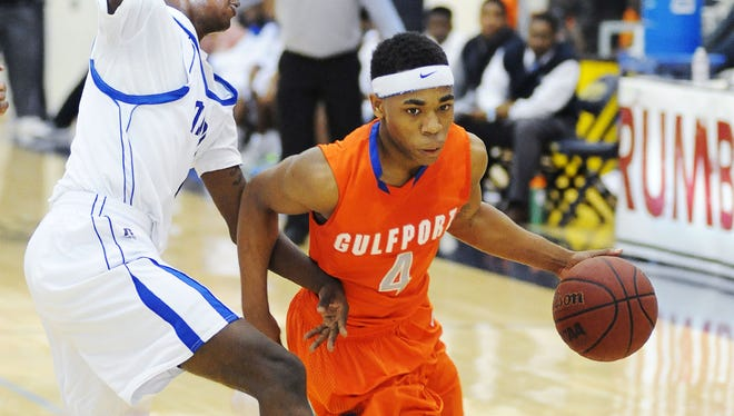 Down three with seconds on the clock, Gulfport's Jahshire Hardnett, right, drives for a shot as Murrah's Aaron James defends during January's Rumble in the South at Mississippi College in Clinton.