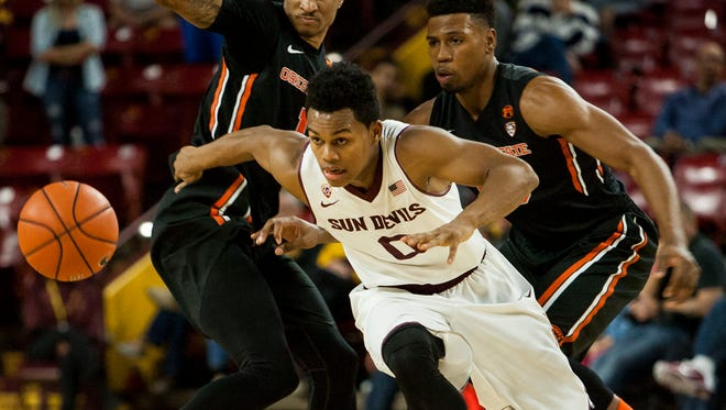 Arizona State freshman Tra Holder chases the ball pushing past Oregon State's Gary Payton II (left) and Langston Morris-Walker at Wells Fargo Arena in Tempe on Wednesday, Jan. 28, 2015.