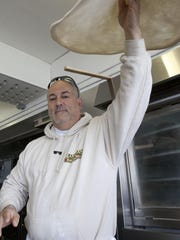 Domenic Maruca, owner of Maruca's Tomato Pies in Seaside Heights, makes a pizza.