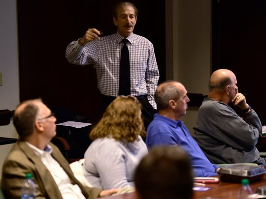 "George Giangi, of South Central Pa. Task Force, leads an ""Response to Active Shooter"" training session Tuesday, Dec. 8, 2015 at Chambersburg Chamber of Commerce. The session was designed to inform guests about options and security precautions they can take if confronted by a gunman in the workplace."