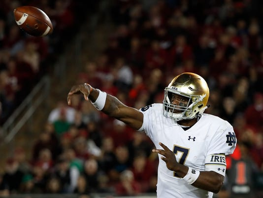FILE - In this Nov. 25, 2017, file photo, Notre Dame quarterback Brandon Wimbush (7) throws against Stanford during the second half of an NCAA college football game in Stanford, Calif. Coach Brian Kelly insists that the inconsistency Wimbush showed this season had nothing to do with overthinking by the Notre Dame quarterback. He says Wimbush is ready for the Citrus Bowl against LSU, and for next season, too. (AP Photo/Tony Avelar, File)