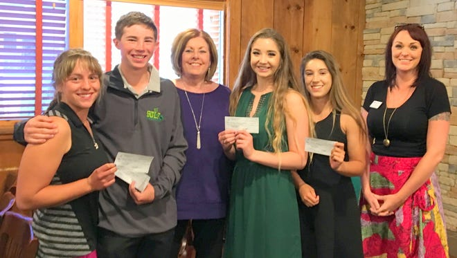 The 2017 Kiwanis scholarship recipients from Ruidoso High School holding their checks are Garrett Eggleston and Sara McMasters both attending New Mexico State University; Lindsey Thomas, attending the University of New Mexico; and Lexi Lucero, attending Western New Mexico University. Kiwanis give four $,1500 scholarships each year to four Ruidoso High School students.  Kiwanis meets the first and third Tuesdays of the month at noon at KBobs.